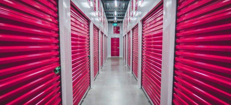 Storage units with pink doors.