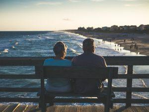An elderly couple at the beach
