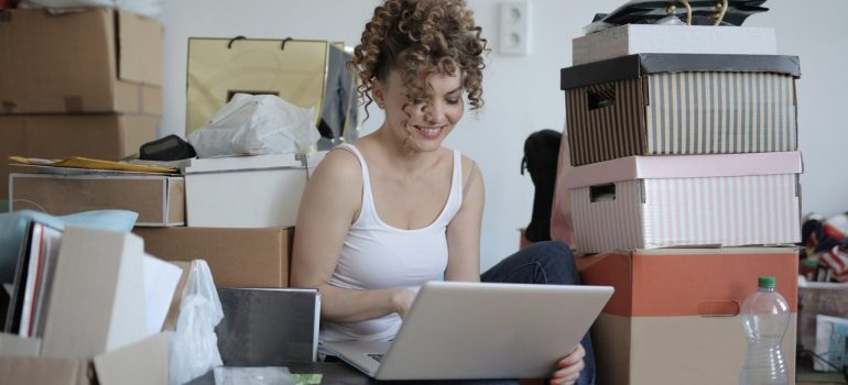 A woman, a laptop and boxes