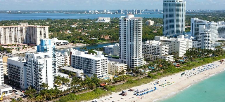 Ocean waters, white sand beach and condo buildings are the reason to buy a vacation home in Sunny Isles Beach.