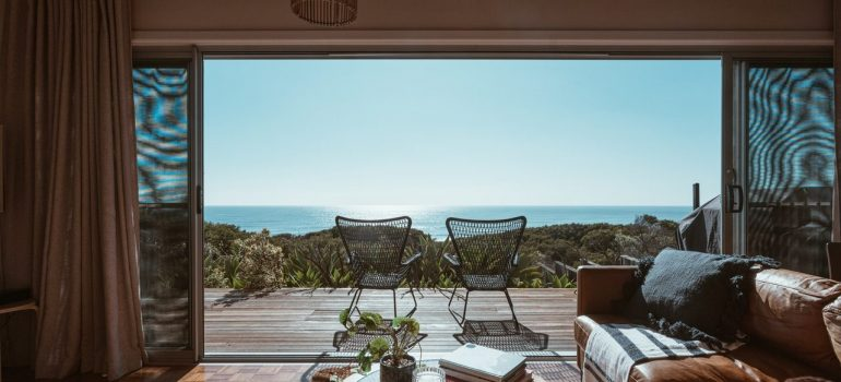 Terrace of the modern villa overlooking the ocean, viewed from the living room.