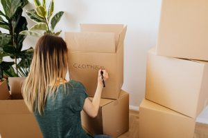 Declutter your Boca Raton home by packing your belongings.