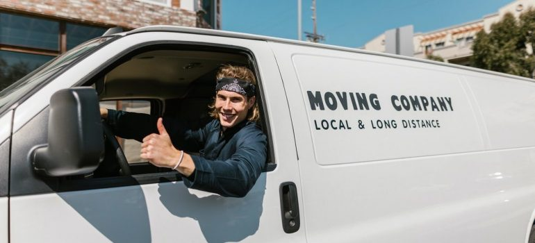 The moving company guy thumbs up