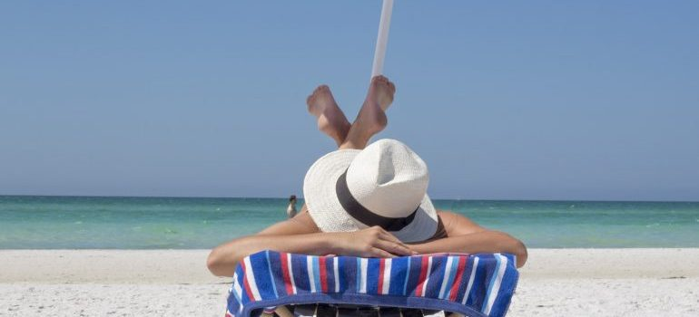 A woman tanning on a beach in Hallandale Beach or North Miami